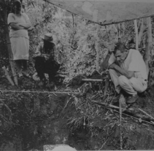 Rufina Amaya watches the excavation of El Mozote graves.