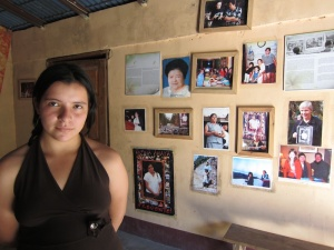 Rufina Amaya's granddaughter, Lesley, in front of a wall honoring her.