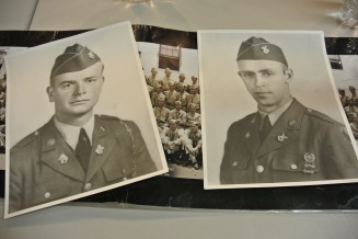 Raymond (L) and Bedford Hoback on top of a photograph of the National Guard they were in.